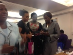 Millicent Saxophonist signing  CD at NTCG Womens Empowerment Conference  2013